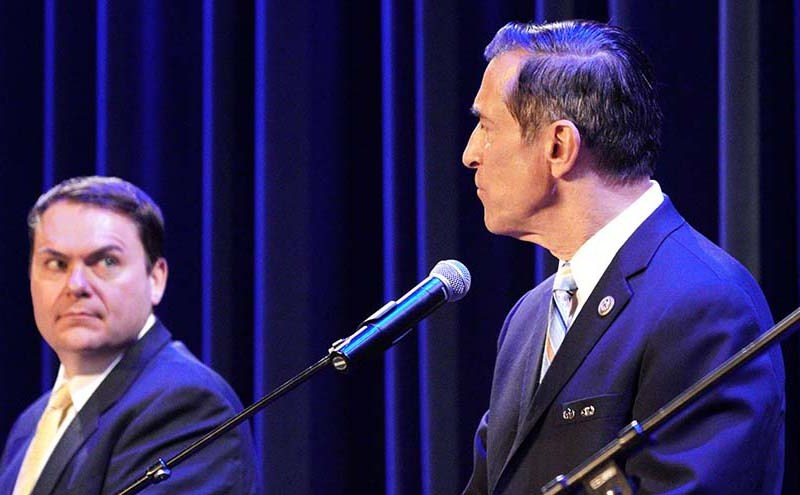 Carl DeMaio (left) eyes fellow GOP candidate Darrell Issa during 2-hour forum at Maxine Theater attended by more than 400 people.