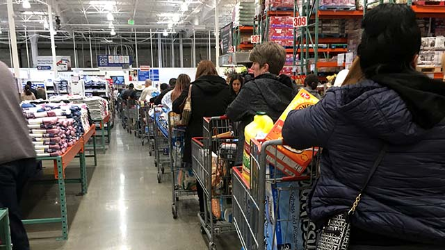 Shoppers at Costco in La Mesa faced long lines as people stocked up on supplies including toilet paper and water.