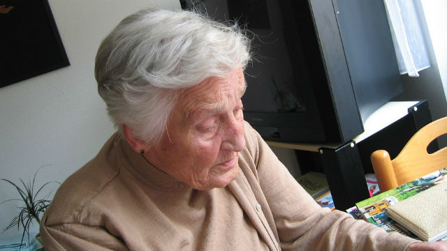 Elderly woman isolated in her home