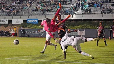 Edward Delgado, goal keeper for the Las Vegas Lights, does a flip after leaping to block a goal attempt.
