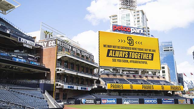"""Amid empty stands, the San Diego Padres displayed a sign: """"We may not be gathered here today, but we are always together."""""""