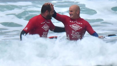 Aitor Francesena or Spain celebrates with his caddy Lukas Garcia after winning in the visually impaired category at the Ampsurf 2020 ISA World Para Surfing Cha