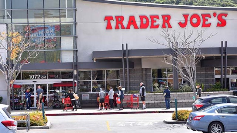 Shoppers are lined up outside a Trader Joe's in Mission Valley.