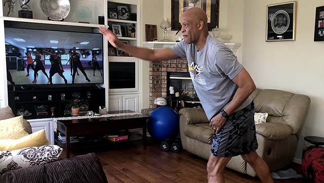 Two-time Olympian Willie Banks does Zumba to stay in shape at his Carlsbad home.