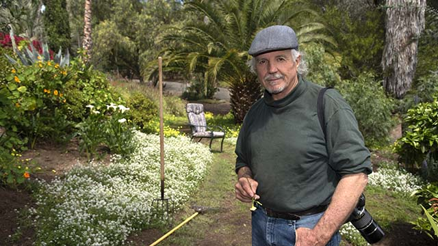 """Don Bartletti, 72, is shown in the Vista garden he's nurtured for 59 years. The retired Los Angeles Times veteran spends much of his """"sequester-at-home"""" time maintaining and photographing his 1-acre sanctuary."""