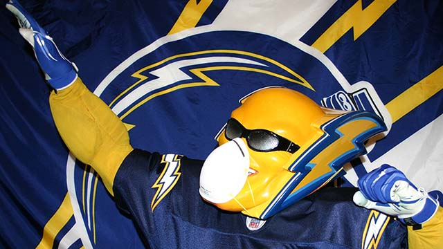 Dan Jauregui, the former Chargers mascot Boltman, wears a mask over his mask at home.