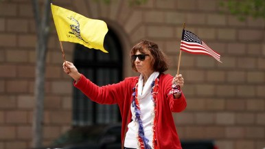 """A woman flew two iconic flags at the """"freedom rally"""" in downtown San Diego."""