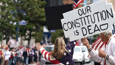 A theme of the rally was the loss of First Amendment rights to assemble.
