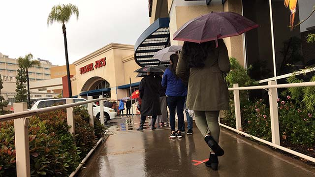 X marked the spots where Trader Joe's shoppers in La Mesa waited before entering the grocery store during recent rains.