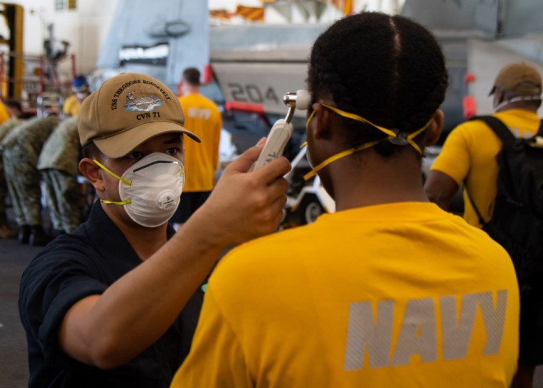 Sailors check each other for fever