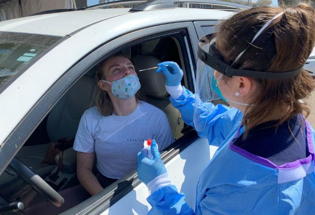 Nurse administers COVID-19 test