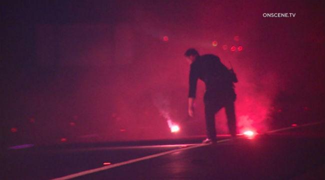 CHP officer examines crash scene