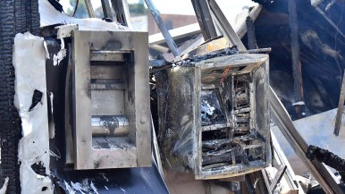 An ATM and a deposit box are destroyed by fire at Union Bank in downtown La Mesa.