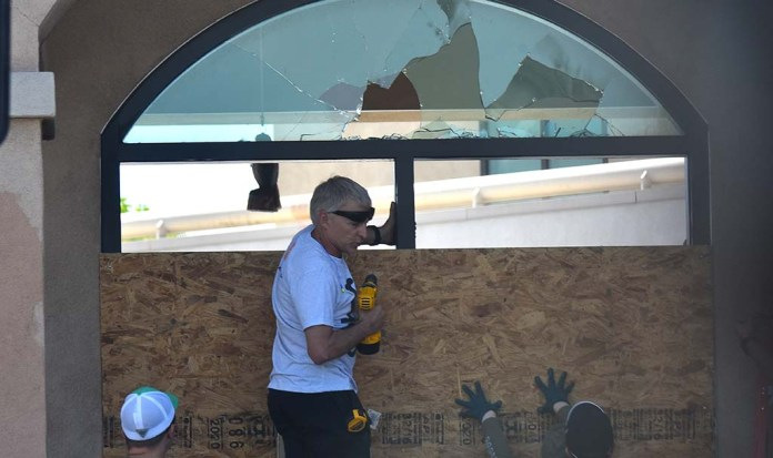 Volunteers gathered by thousands of people in La Mesa on Sunday morning to repair the damage done by protesters the night before, such as the window of the La Mesa Police Department.