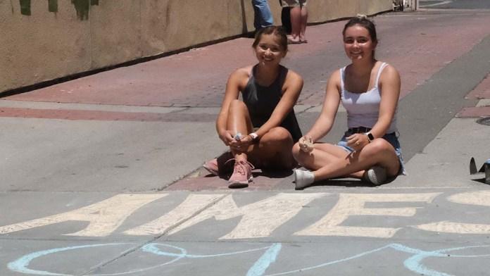 Sofia Kruse and Meakalia Gilman conveyed the chalk message