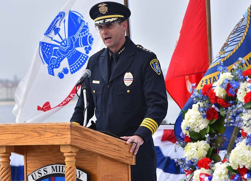 San Diego Police Chief David Nisleit pays tribute to fall military members aboard the USS Midway on Memorial Day.