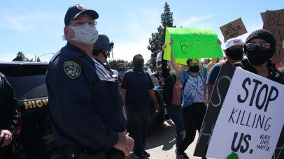 Highway Patrol officers watched the protest on an Interstate 8 eastbound onramp. Photo by Chris Stone