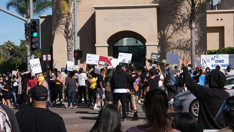 Marchers congregated outside la Mesa police station on their way back from a march.
