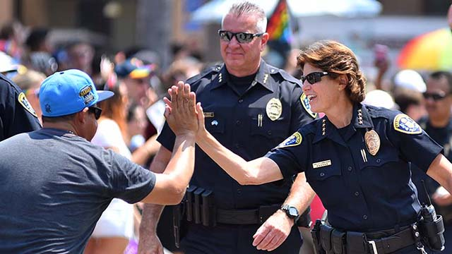 Then San Diego Police Chief Shelley Zimmerman gets a high-five from a man in the crowd at the 2017 San Diego Pride Parade.