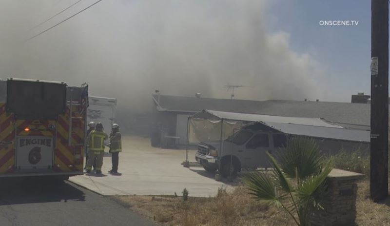 Firefighters outside burning home