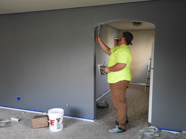 A man painting a room