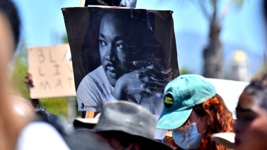 Several protesters in La Mesa carried signs with photos and quotes of the late Rev. Martin Luther King, Jr.
