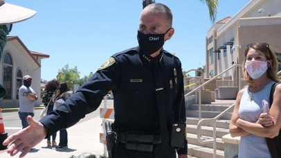 La Mesa Police Chief Walt Vasquez extends a hand to someone he recognized at a protest on June 14.