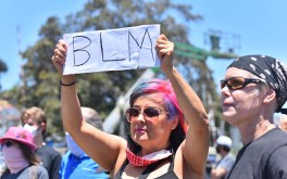 Some protesters brought signs demonstrating their support of the Black Lives Matter protest at the La Mesa Police Department parking lot.
