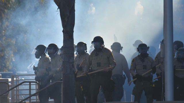 Tear gas envelops sheriff's deputies in front of La Mesa police station entrance on May 30.