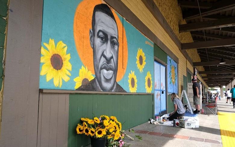 Artist Chloe Becky painted the image of George Floyd, the man killed in police custody in Minneapolis , near a beauty school.