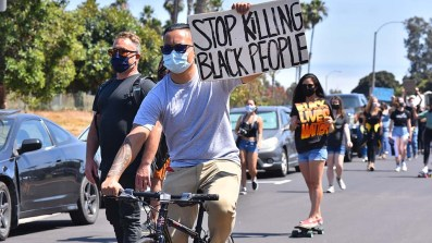 About 100 young protesters showed their support for the Black Lives Matter movement by traveling up Mission Bay Drive with signs.