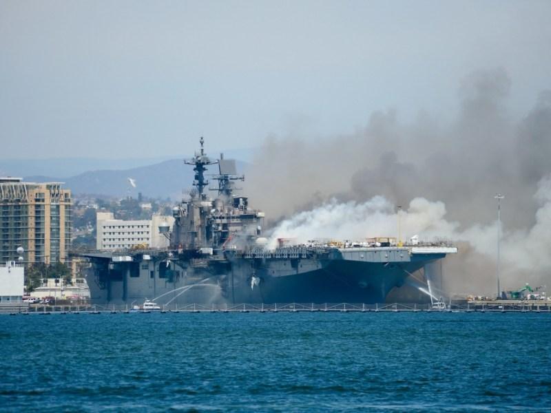 Harbor Police boats spray water on the USS Bonhomme Richard