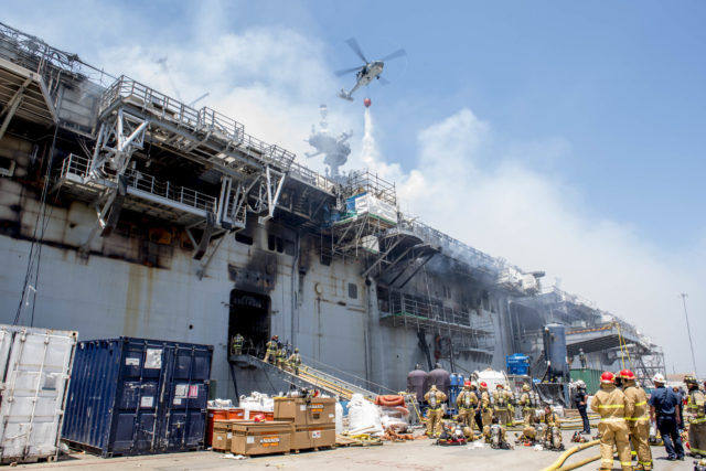 Helicopter drops water on USS Bonhomme Richard