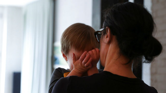 A mother comforts her child during the pandemic