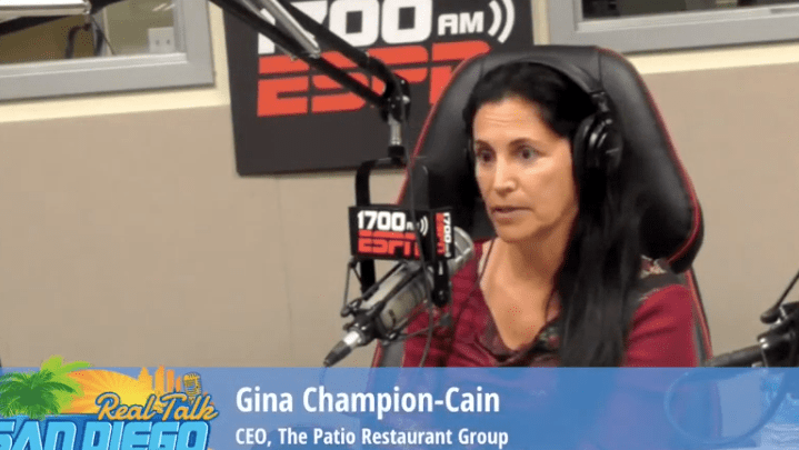 Gina Champion-Cain being interviewed on ESPN in 2015.