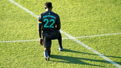 San Diego Loyal player Francis Atuahene kneels for 15 seconds for racial equality before the start of the match.