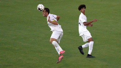 LA Galaxy's Jesus Vazquez (left) does a header while Jalen Neal watches during a match with San Diego Loyal at USD.