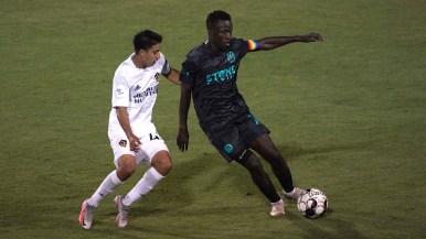 Loyal Tumi Moshobani (right) takes control of the ball against LA Galaxy I at Torero Stadium at the University of San Diego.