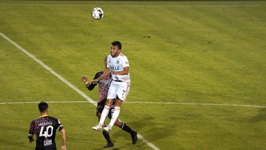 Loyal player Carlos Alvarez leaps for a header in a match at Torero Stadium at USD.