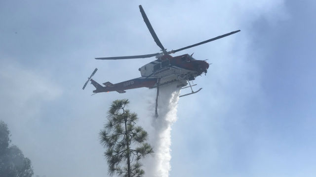 San Diego Fire-Rescue helicopter drops water