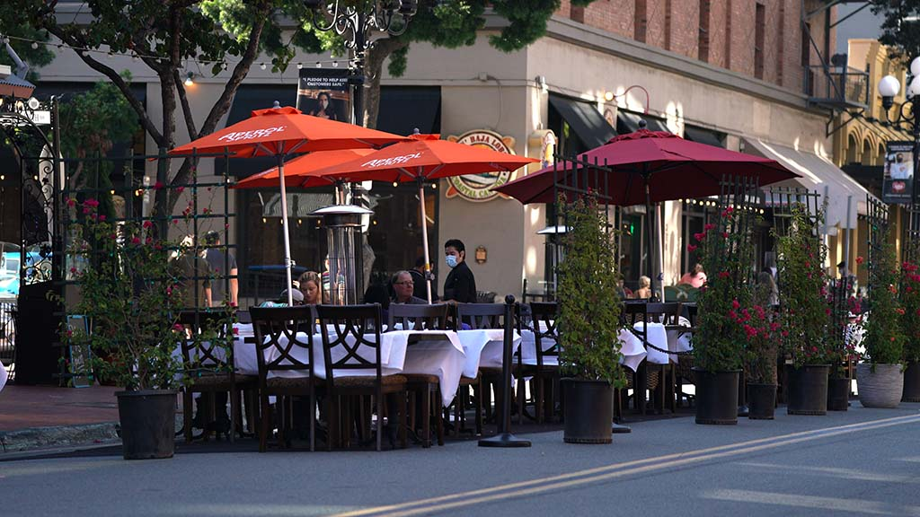 Customers are served outdoors on Fifth Avenue in the Gaslamp at Rockin' Baja Lobster.