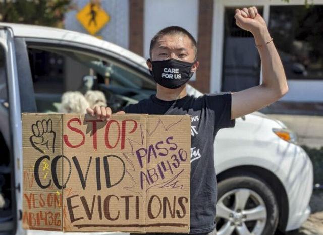 Eugene Vang, 19, demonstrates against evictions during the COVID-19 pandemic