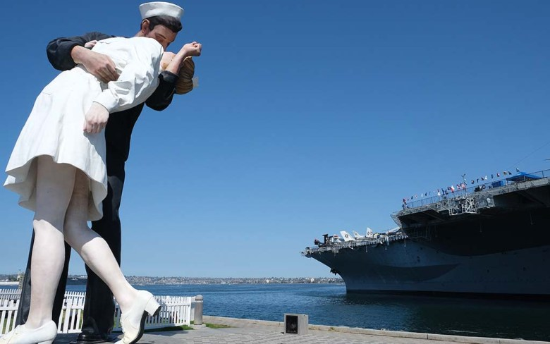 The statue symbolizing the celebration of Victory Day in 1945 sits adjacent to the USS Midway Museum.