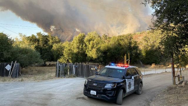 San Diego Sheriff's deputies patrol an evacuation area