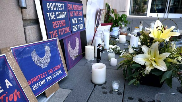 San Diegans left candles, flowers and signs at the Superior Court building downtown to pay tribute to Supreme Court Justice Ruth Bader Ginsburg following her death on Sept. 18.