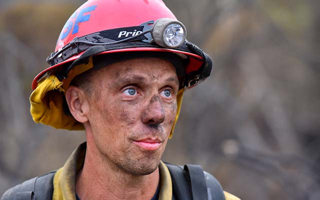 Capt. Luke Bennett of Rancho Santa Fe Fire protection said surviving firefighting in triple-digit weather requires drinking copious amounts of water and moving continually because it feels cooler.