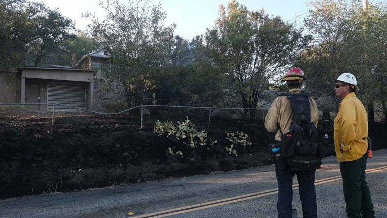 Firefighters survey damage from blaze surrounding home on Viejas Grade Road.