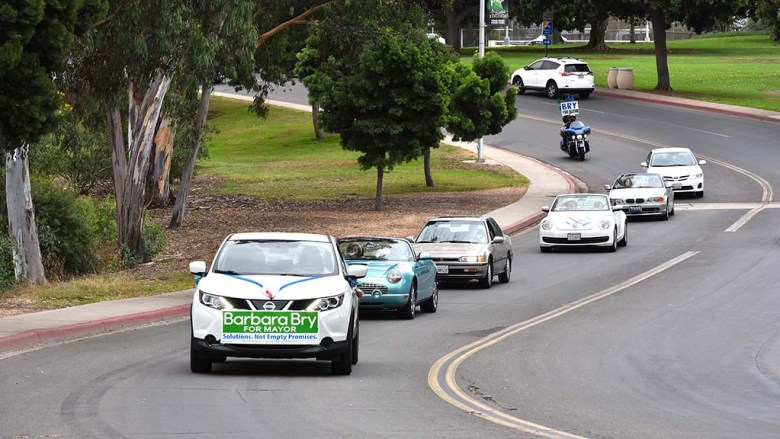 Part of the caravan for San Diego City Councilwoman Barbara Bry makes its way through an s curve in Balboa Park