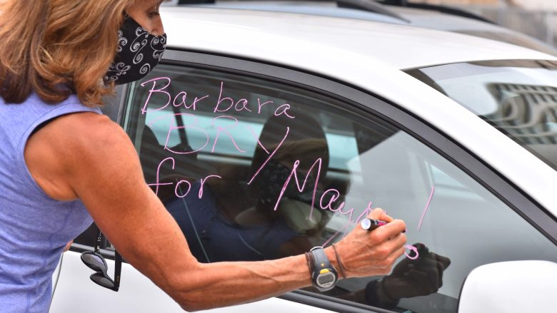 Marcella Teran of Pacific Beach prepares her car for a campaign caravan for mayor candidate Barbara Bry.