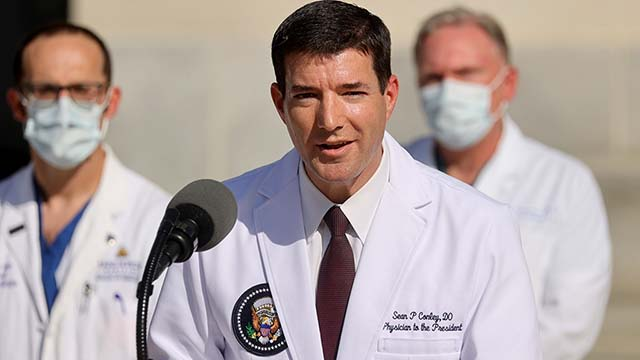 U.S. Navy Commander Dr. Sean Conley, the White House physician, talks to the media Oct. 3 about Donald Trump's health after the president was hospitalized for coronavirus disease treatment at Walter Reed National Military Medical Center, in Bethesda, Maryland. Photo by Ken Cedeno via Reuters